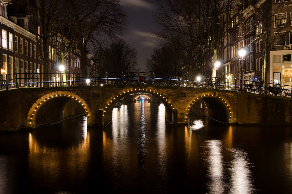 Photography of Brown Concrete Bridge at Night