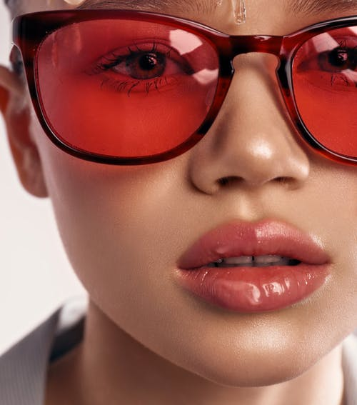 A Woman in Red Framed Eyeglasses