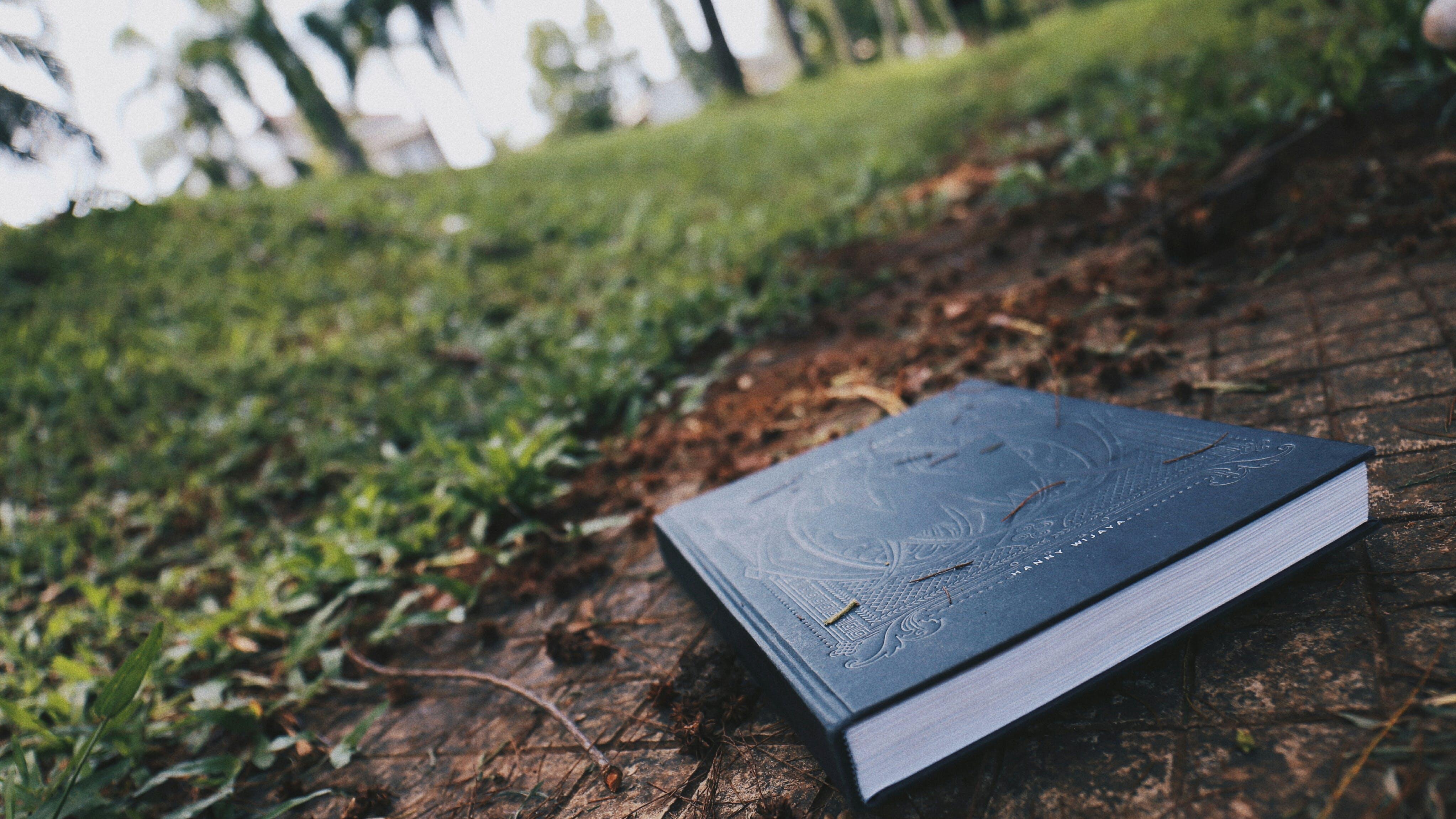 Black Book on Brown Floor