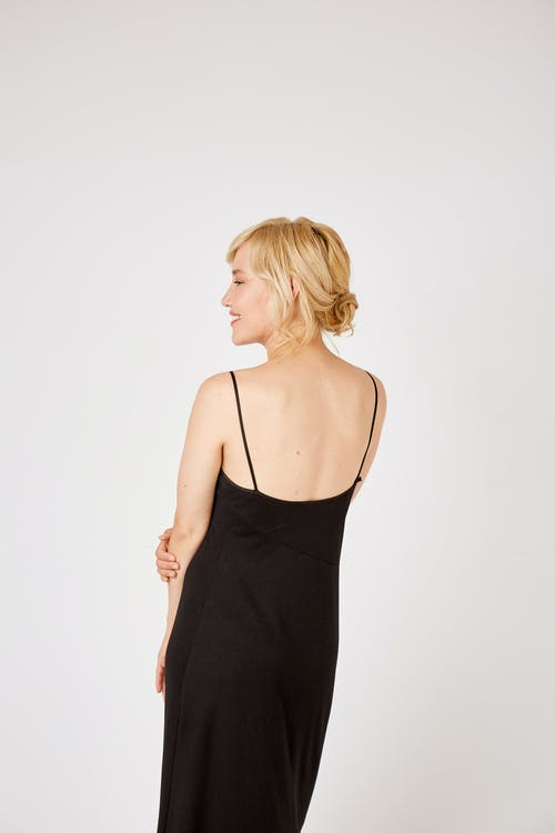 Back View of a Blonde-Haired Woman in Black Spaghetti Strap Dress