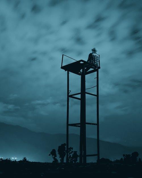 Black Metal Tower on Top of Mountain