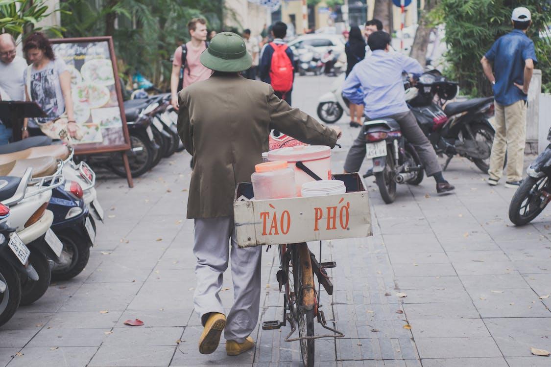 Man Walking With Bike