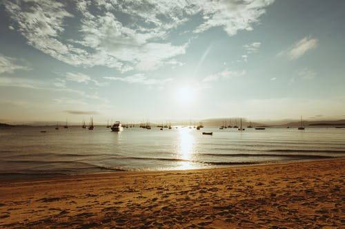 Gratis stockfoto met aan het strand, avond, avondzon