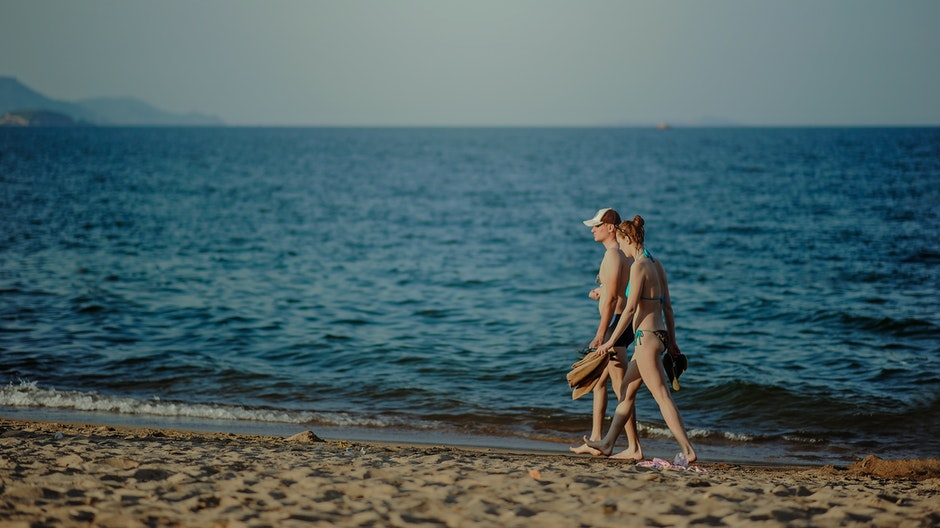 Couple Walking on the Beach at Daytime