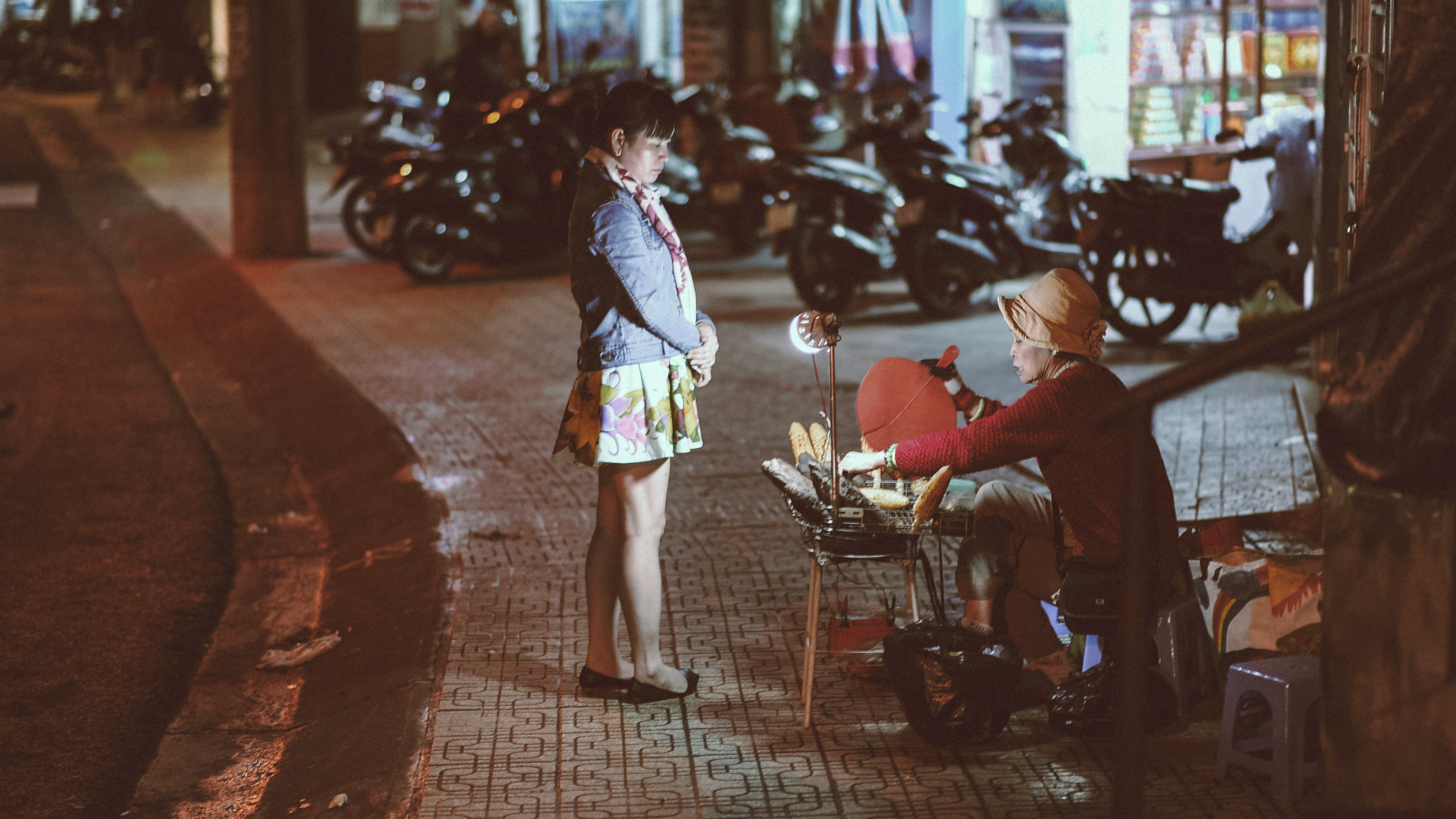 Woman buying from a street vendor