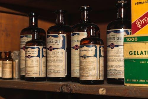 Foto stok gratis apotek, apotek antik, botol kecil, obat