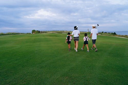 Family Walking on Golf Course