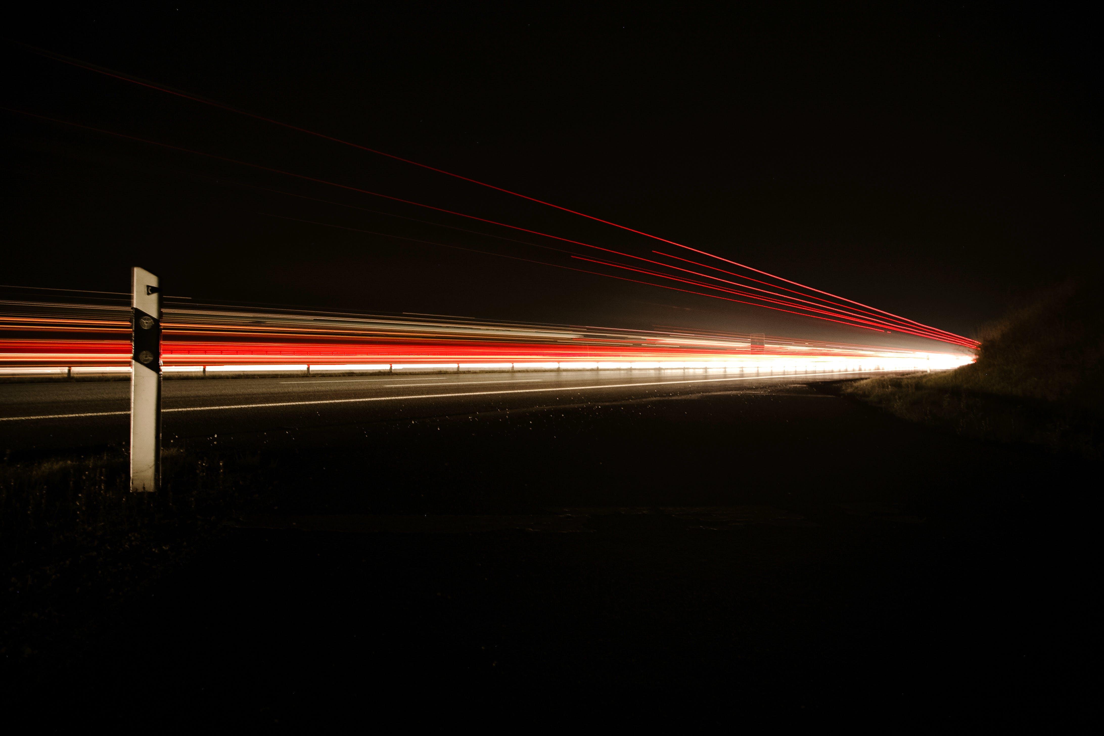 Night Photo of Car Lights on Bridge