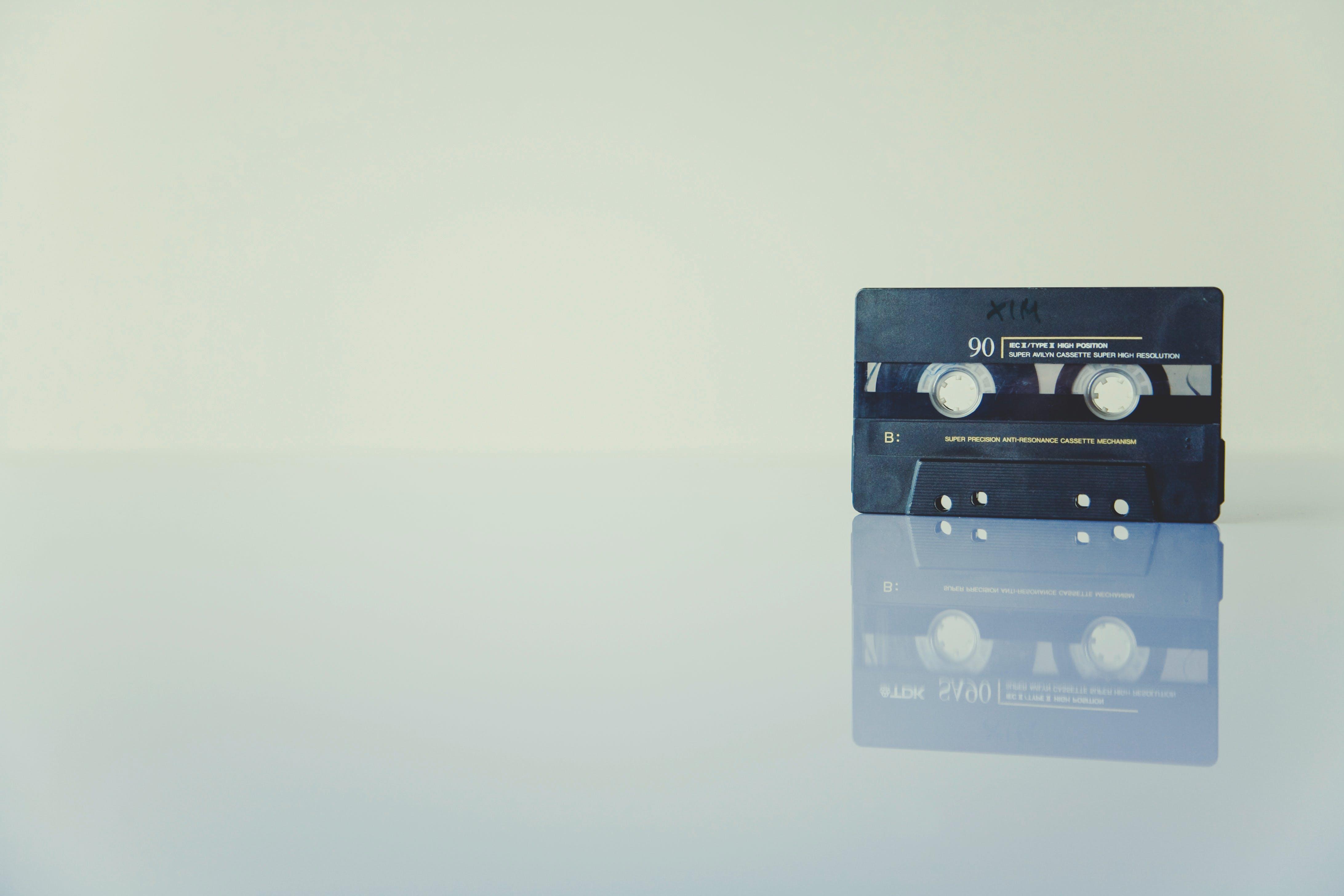 Black Cassette Tape Standing on White Surface