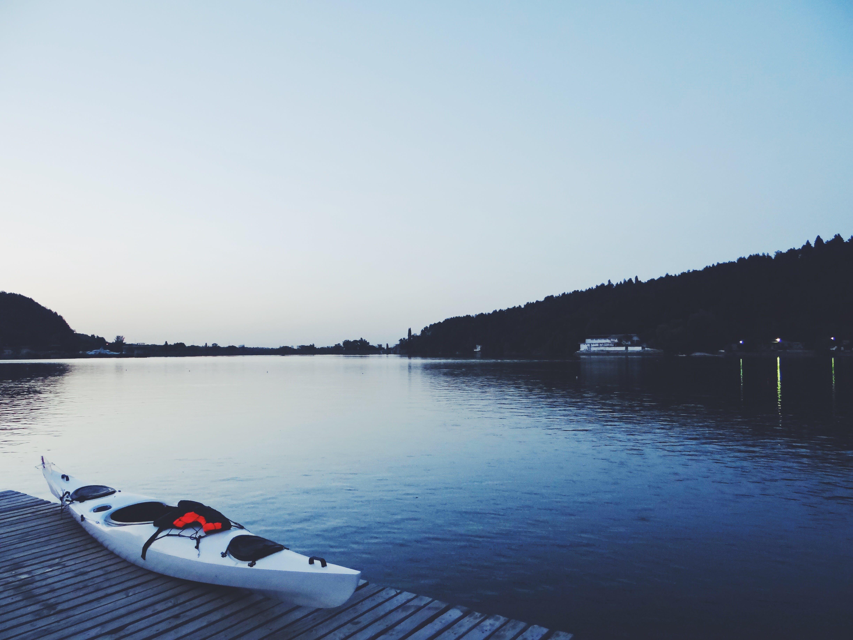 White Kayak on Brown Wooden Dock