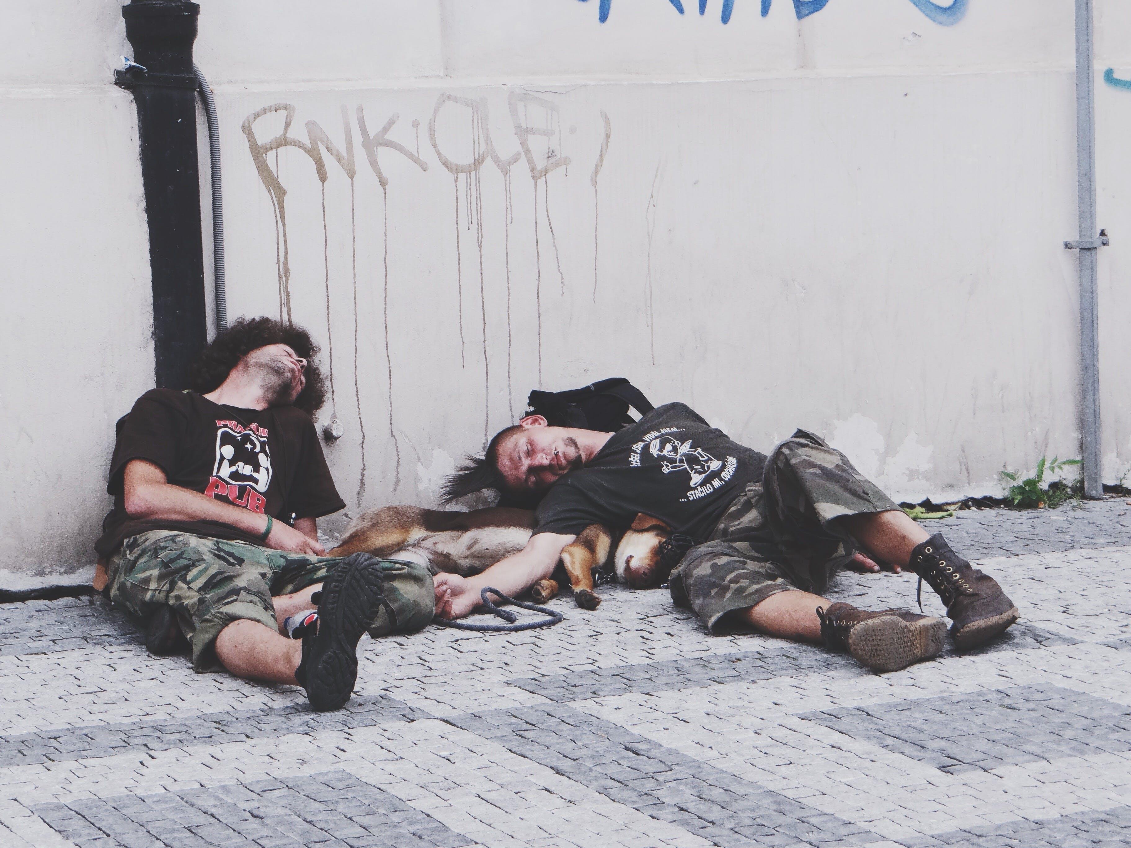 Photo of Men Sleeping on the Street