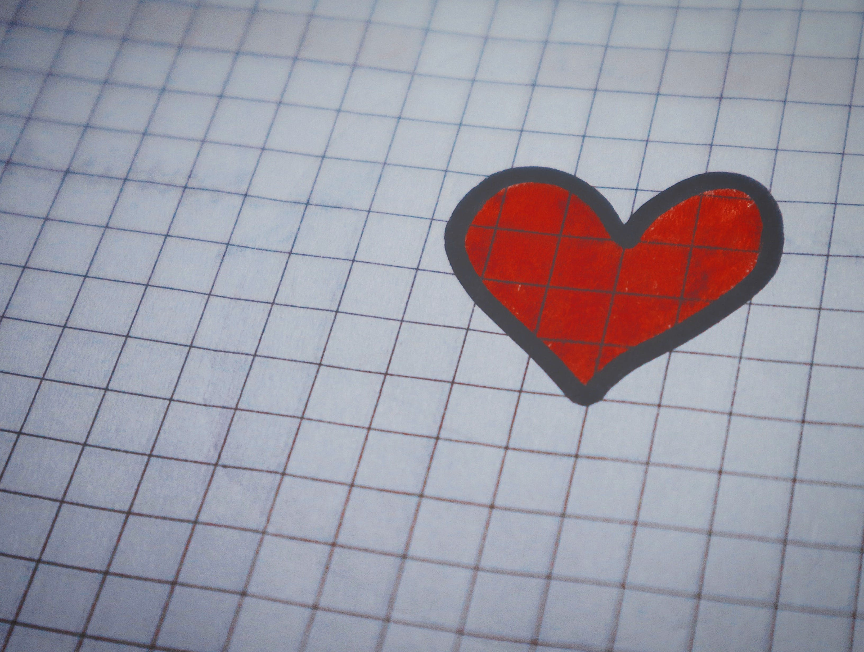 White Page of Graphing Paper With Red Heart Drawing