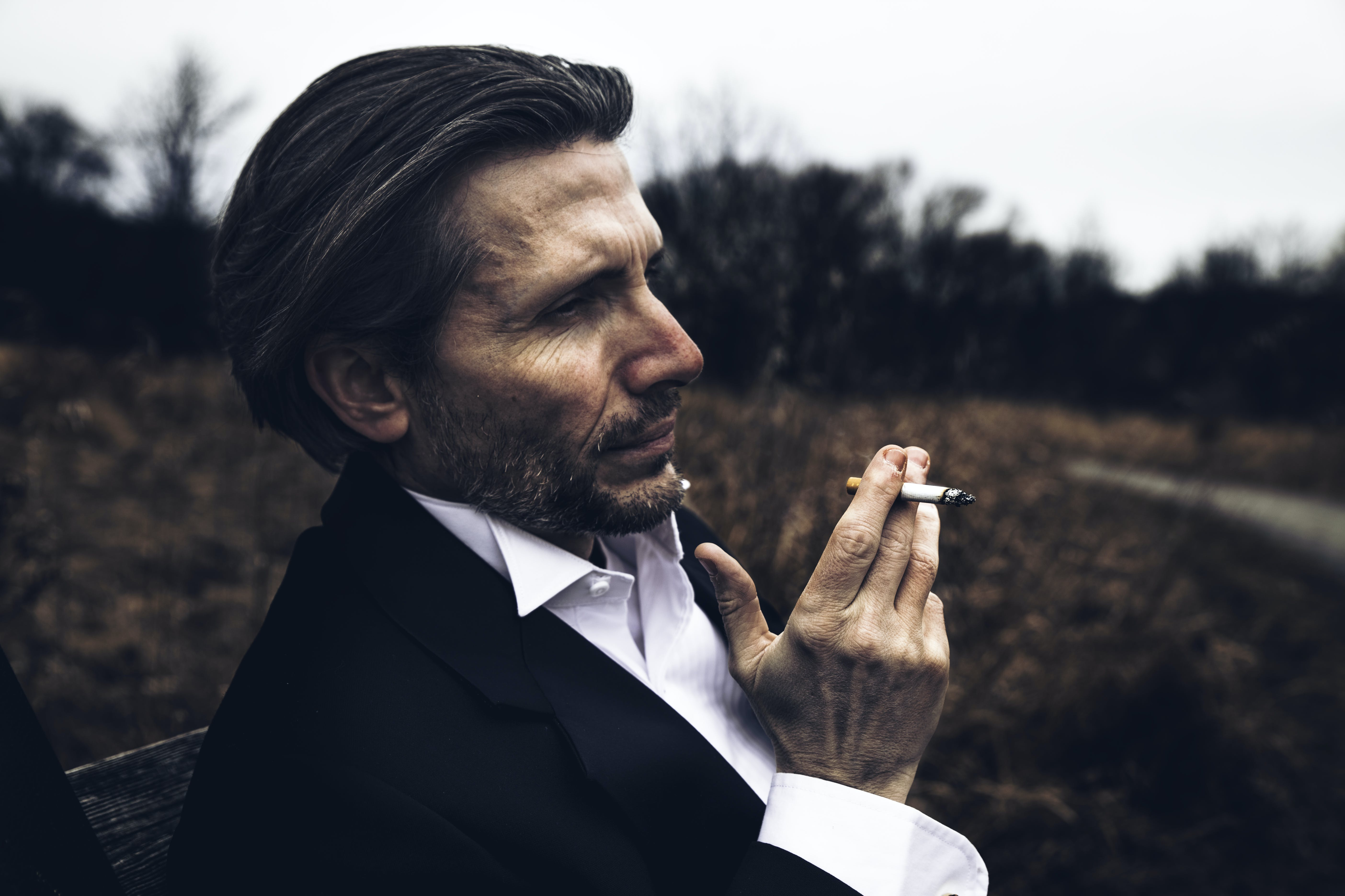 Photo of Man Holding a Cigarette