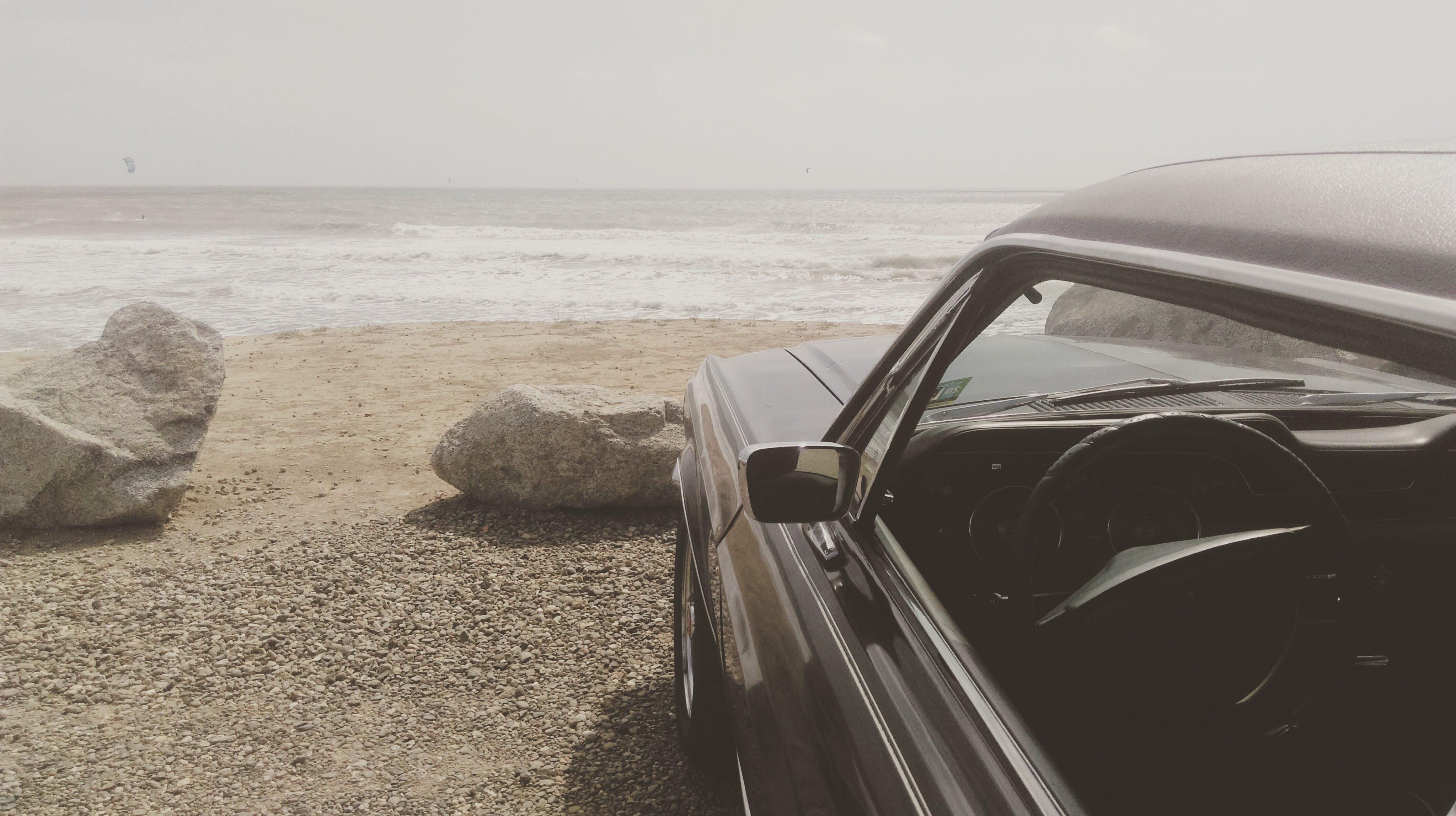 Black Car Parked on the Seashore