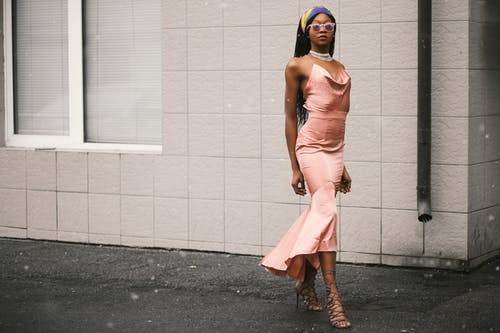 Woman Wears Pink Spaghetti-strap Dress