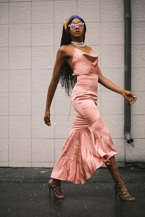 Photo of Woman in Pink Spaghetti Strap Top and Pink Long Skirt