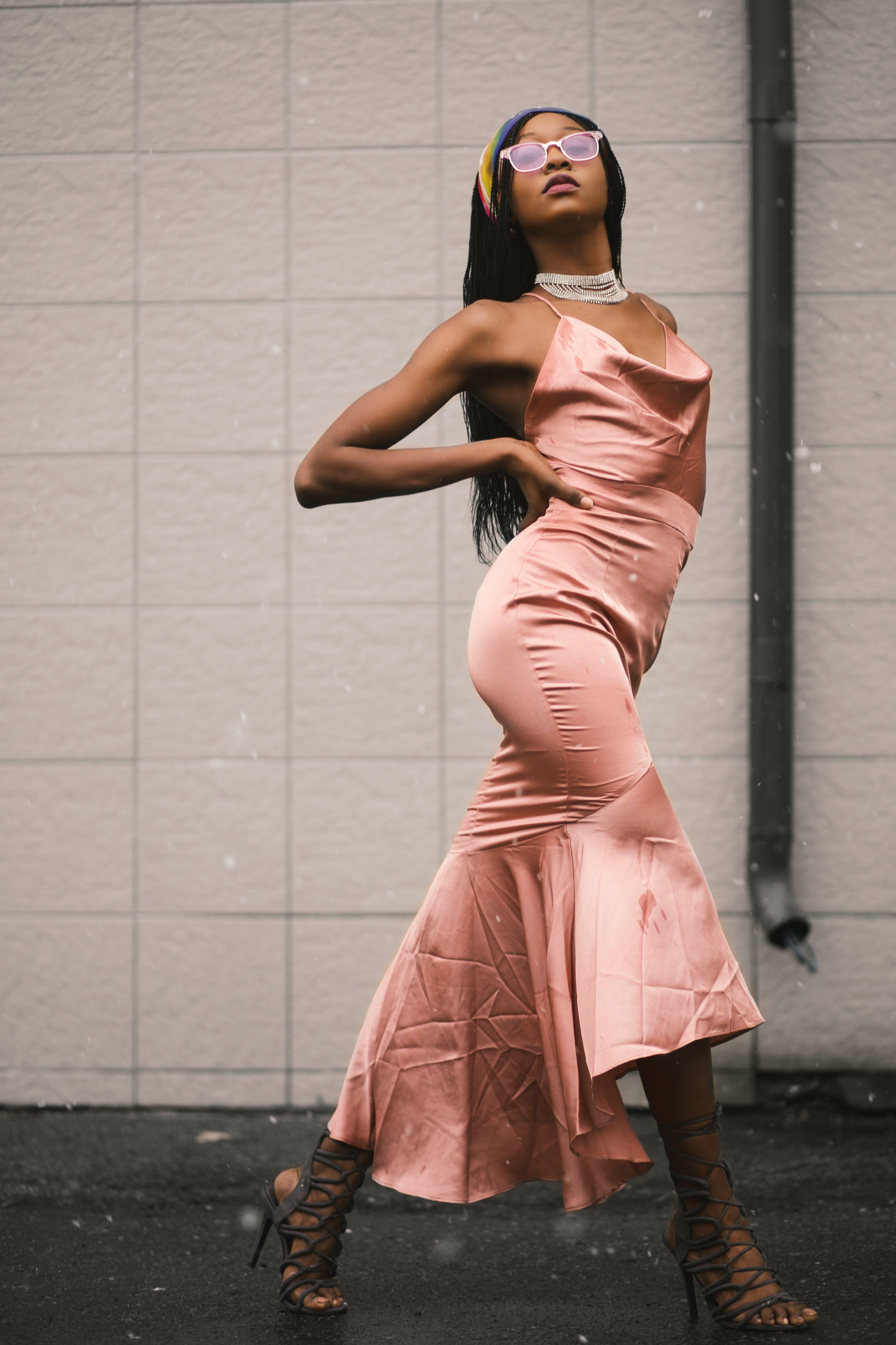 Woman in Pink Spaghetti Strap Dress