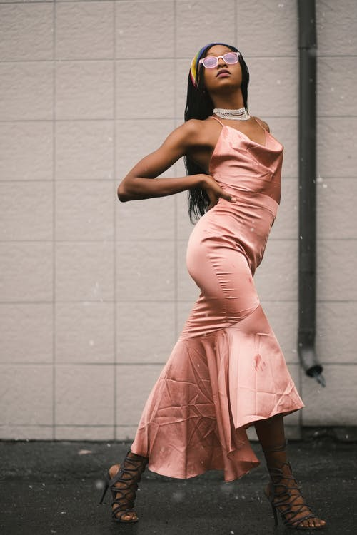 Woman in Pink Spaghetti Strap Dress