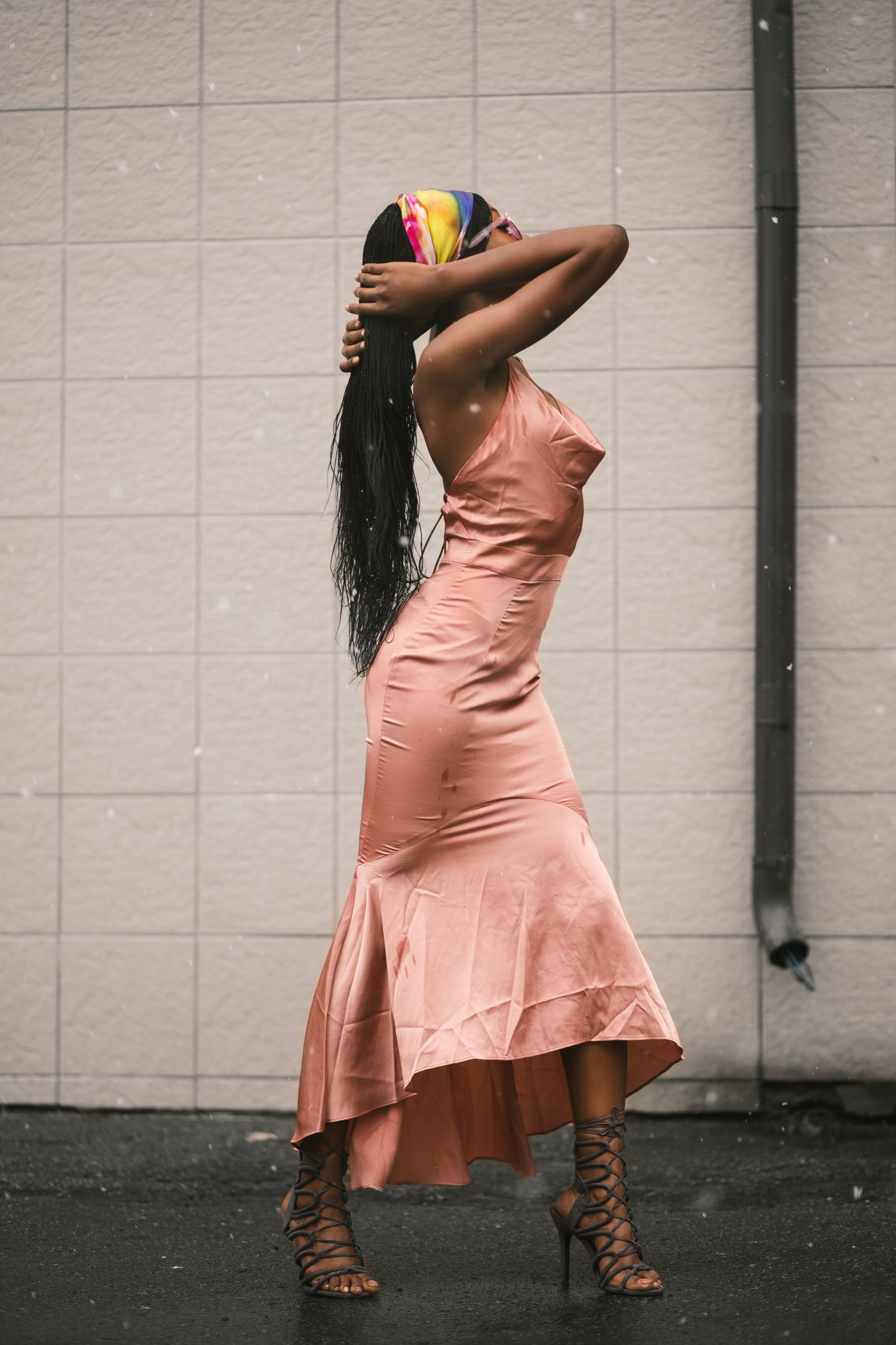 Woman in Pink Dress Hold Hair