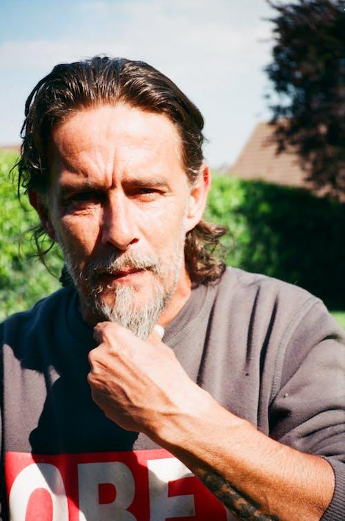 Man in Gray Long Sleeve Shirt