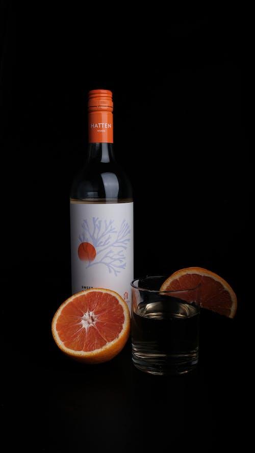 Orange and White Labeled Bottle