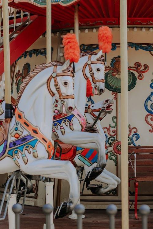 White Plastic Carousel Horses