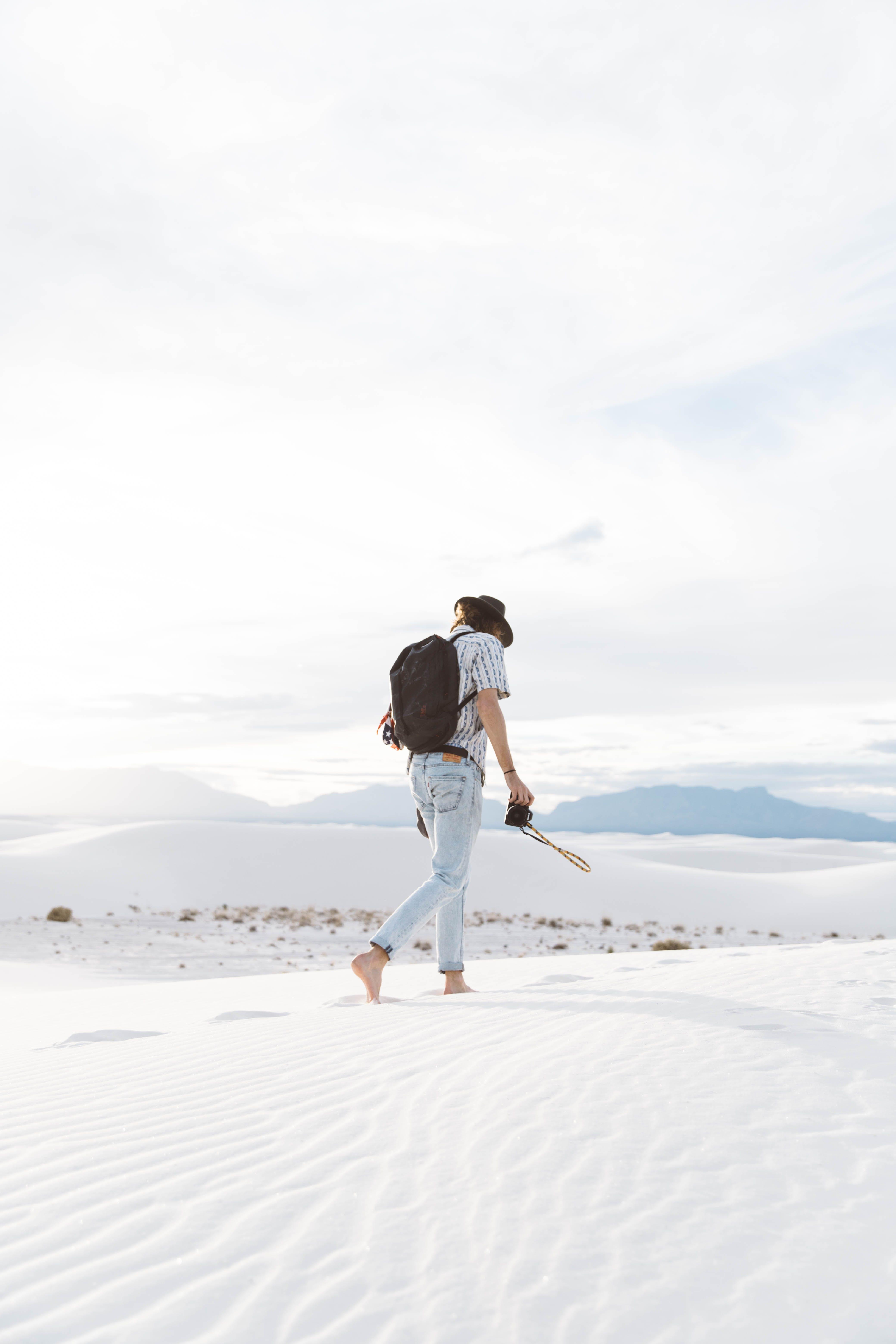 Photo Of Person Walking Along Seas