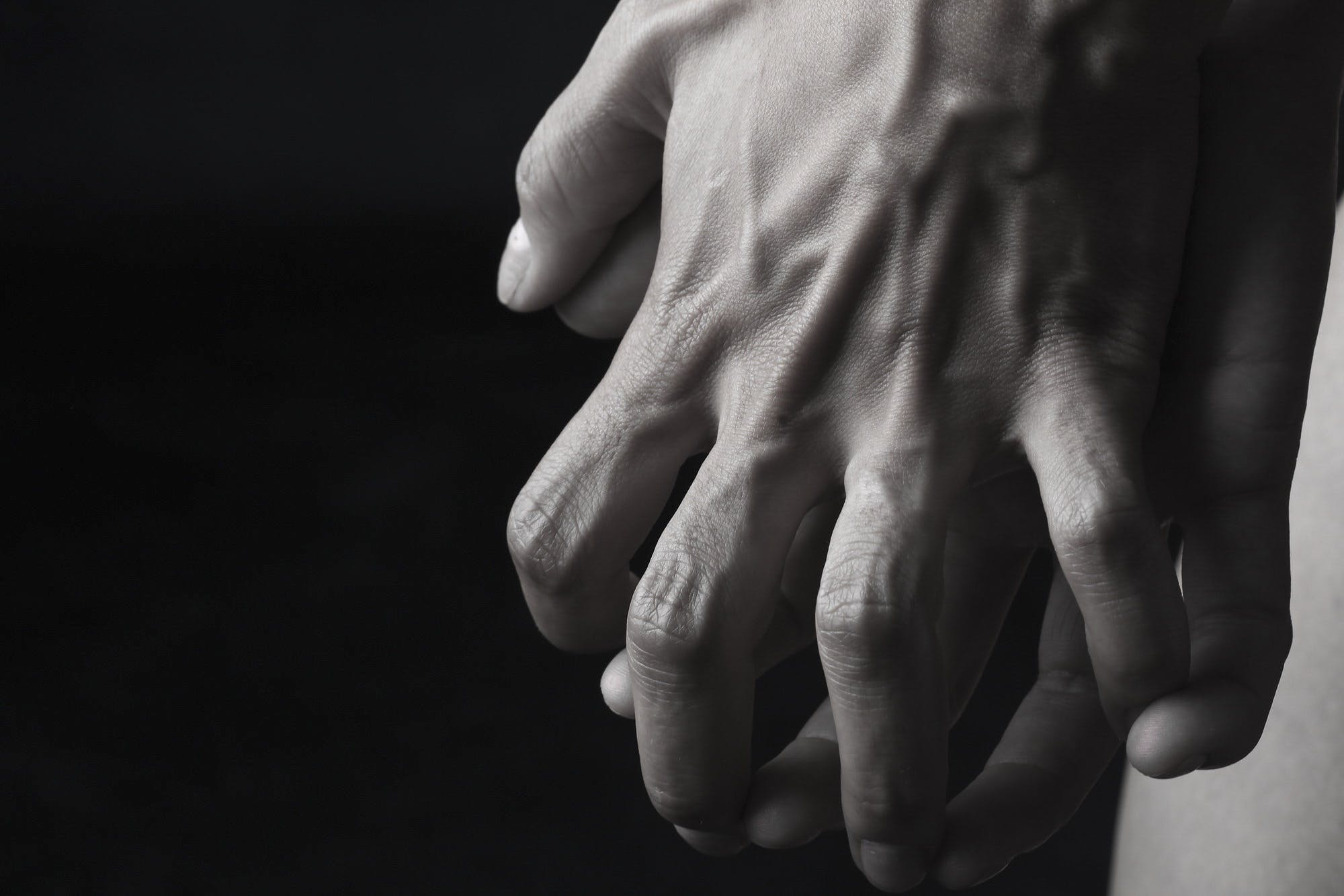 Two Hands About to Hold Grayscale Photography