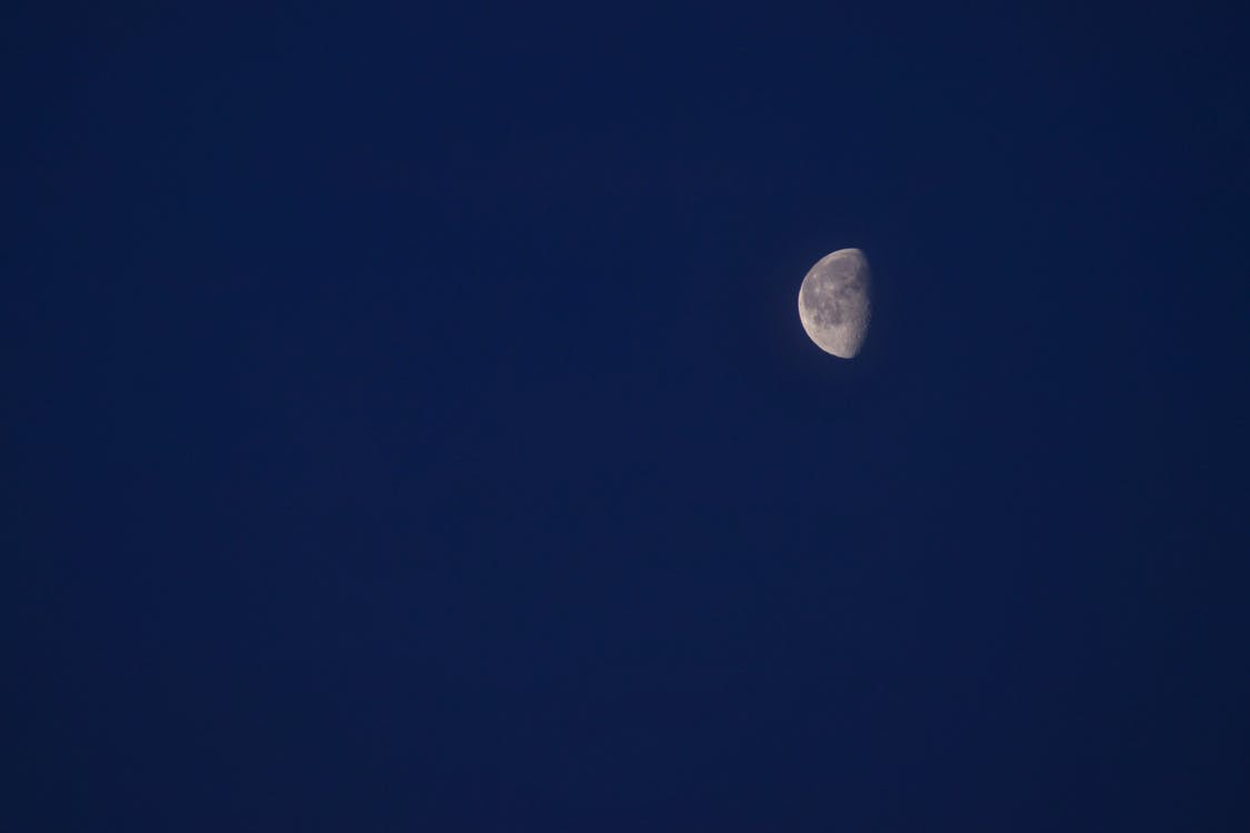 Half Moon Under Clear Blue Sky
