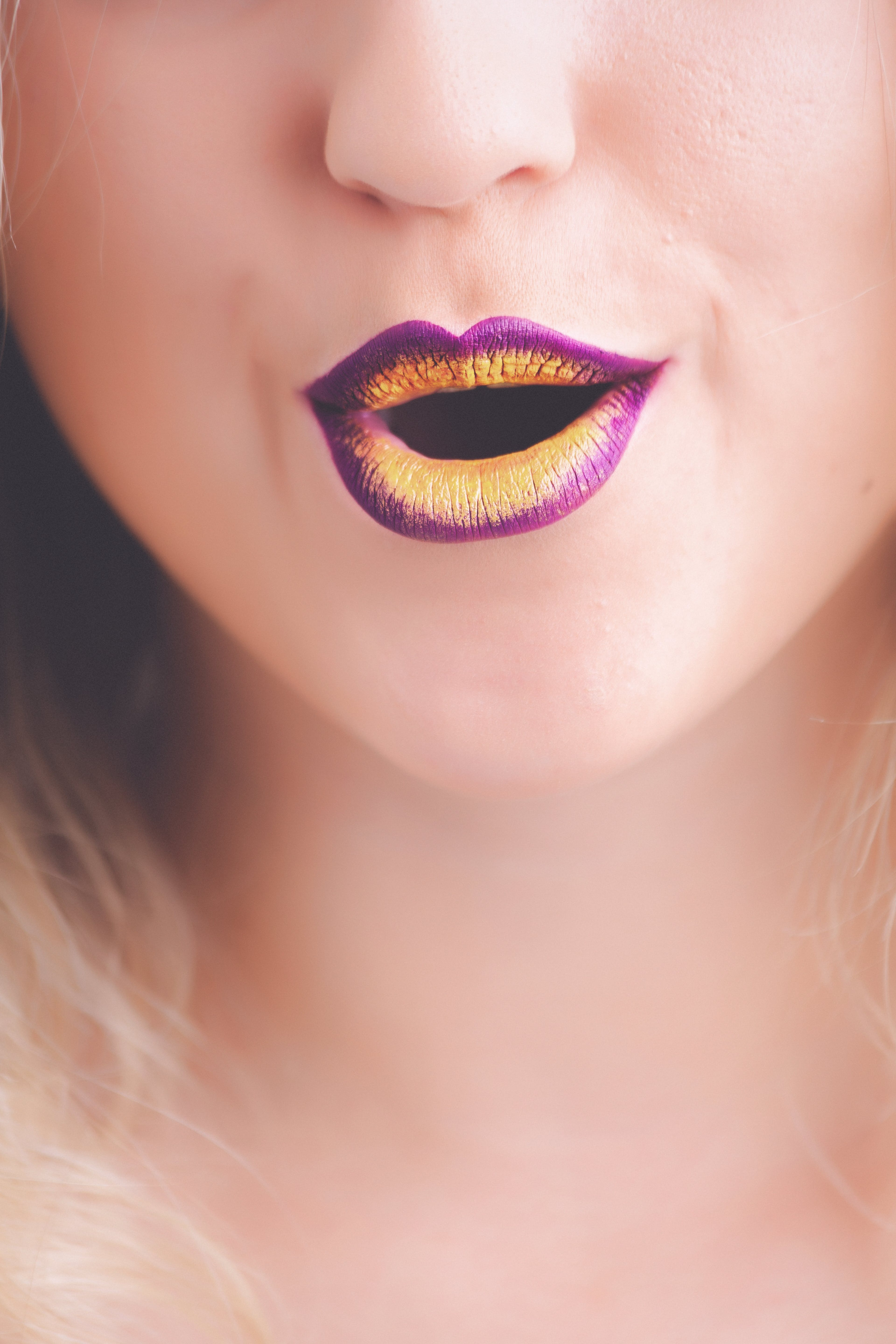 Woman With Purple and Yellow Lipstick