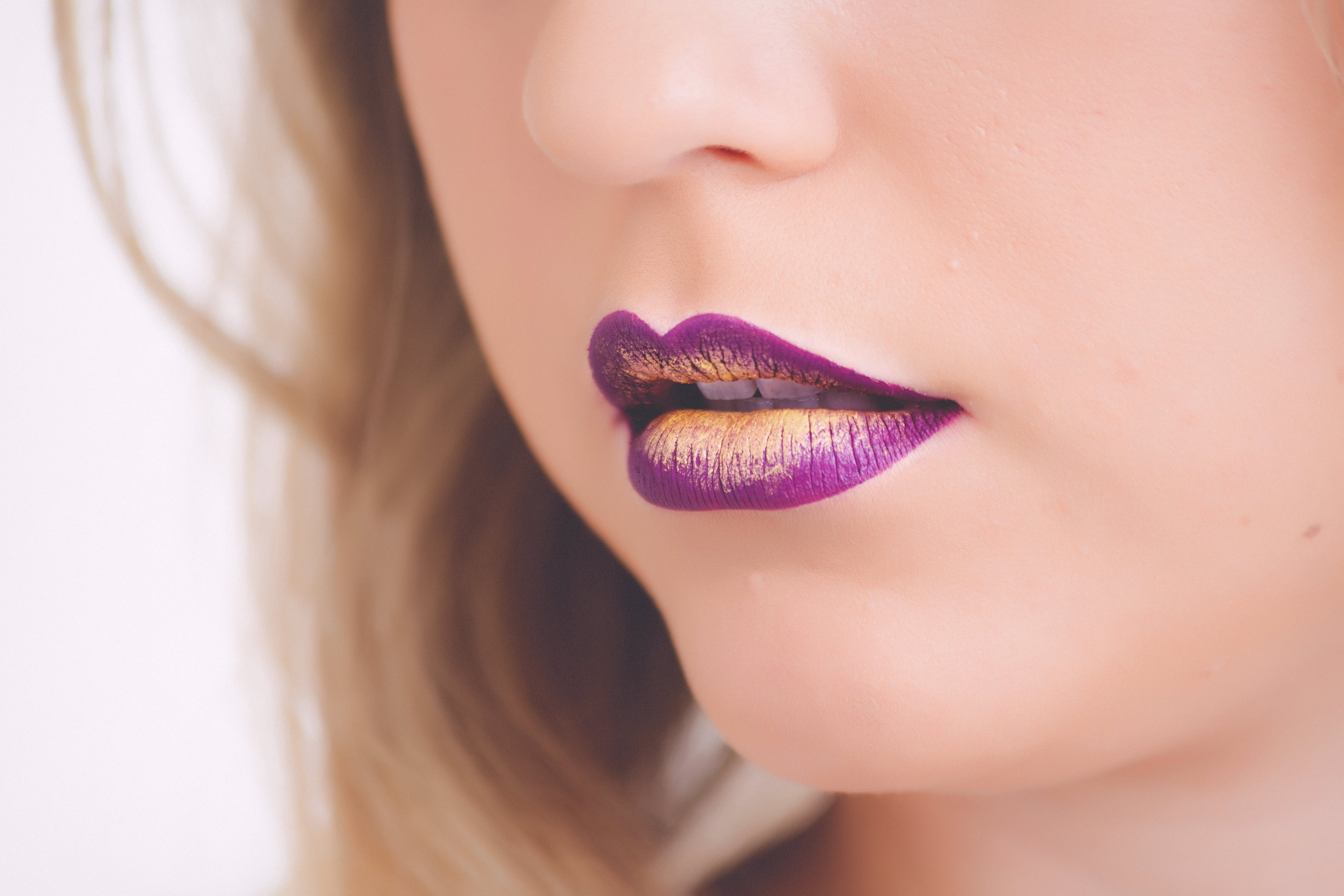 Woman Wearing Purple and Beige Lipstick