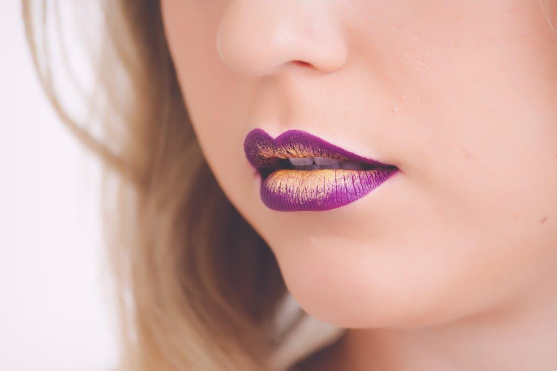 Woman Wearing Purple and Beige Lipstick
