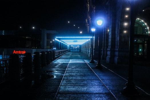 Black Outdoor Pedestal Lamp Near Coaster Train Rail