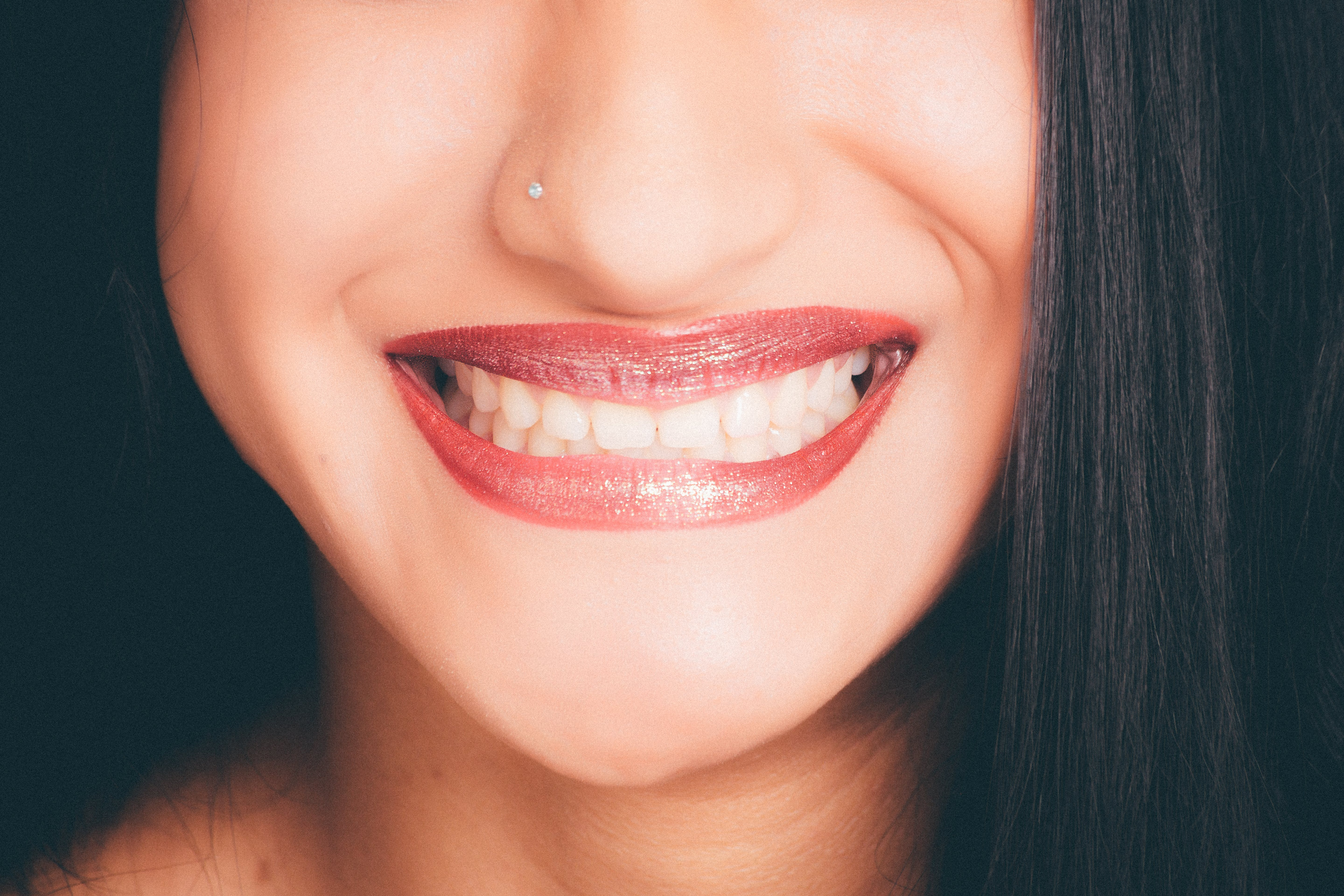 Woman with a Big Smile and Red Lipstick