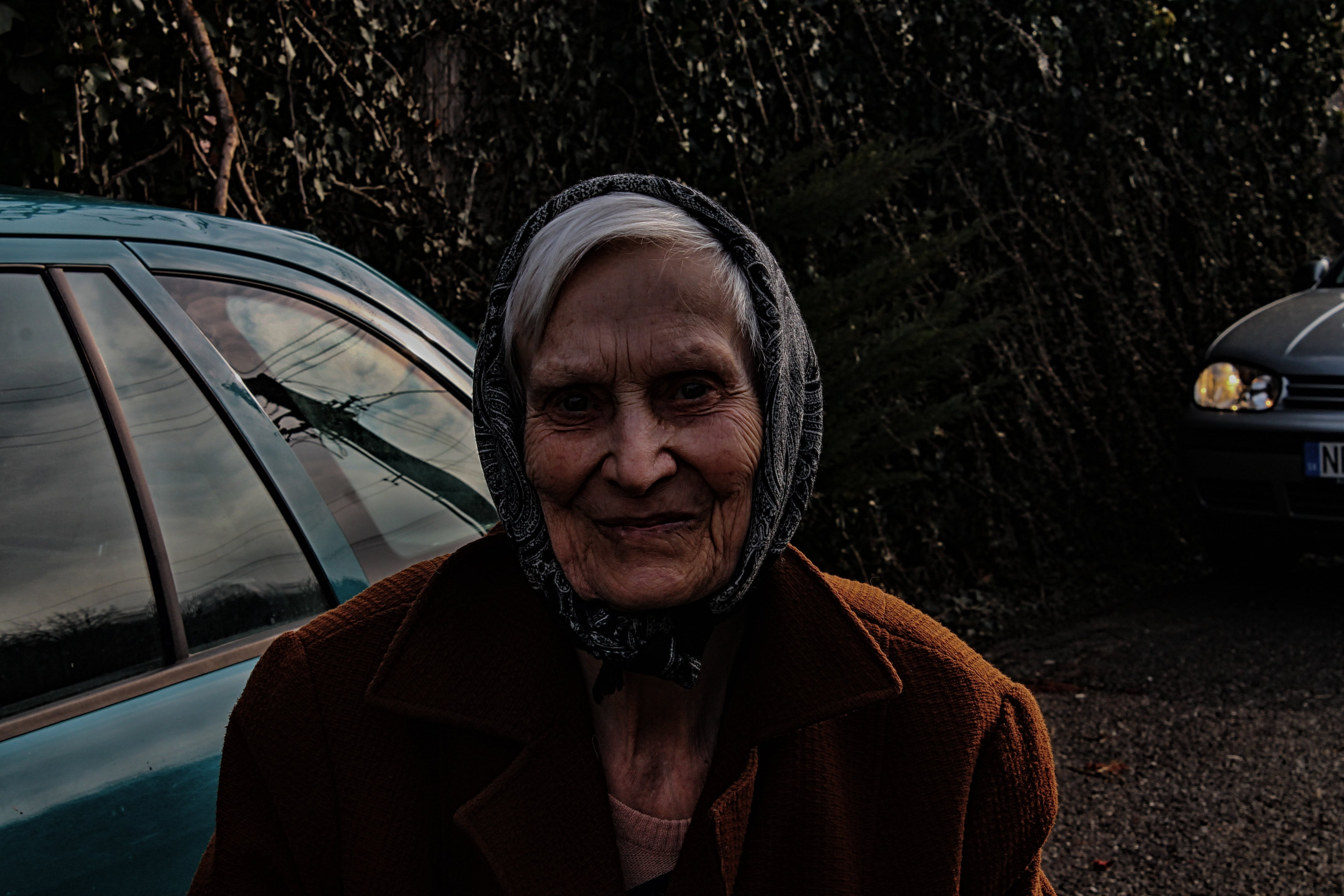 Woman Wearing Brown Jacket and Black Head Scarf