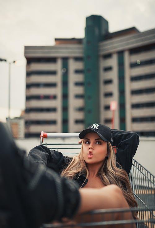 Woman in Black Jacket Wearing Black Cap