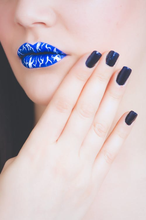Woman Wearing Blue and White Lipstick With Black Manicure