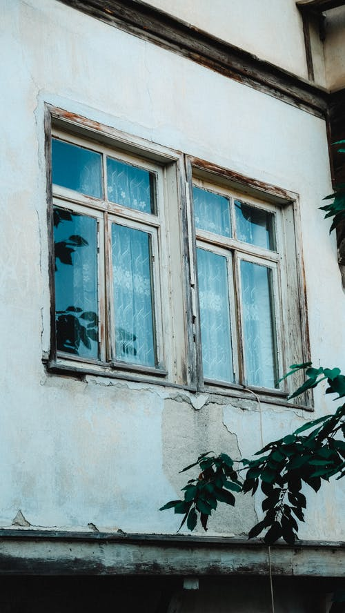 White Wooden Frames of Glass Windows on Concrete Wall