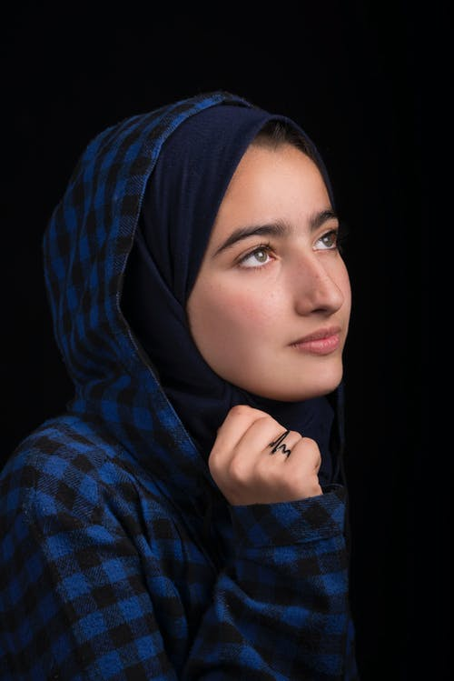 Woman in Black and Blue Plaid Headscarf
