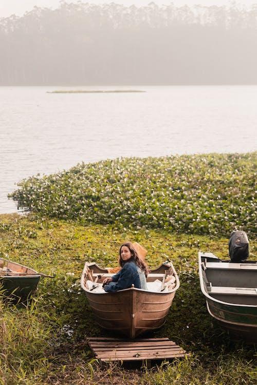 2 Women in Boat on Body of Water