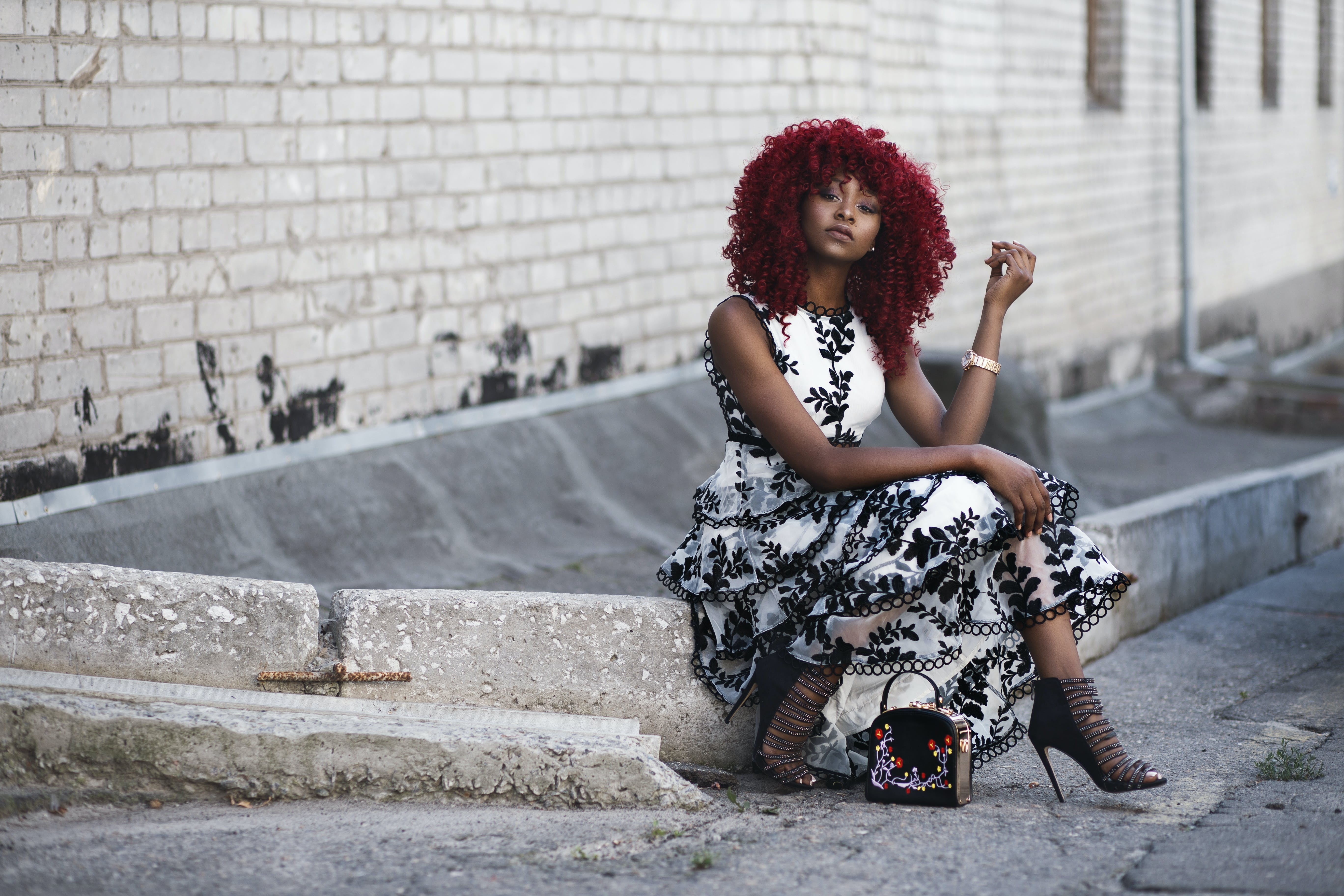 Red Haired Woman in White and Black Floral Sleeveless Maxi Dress
