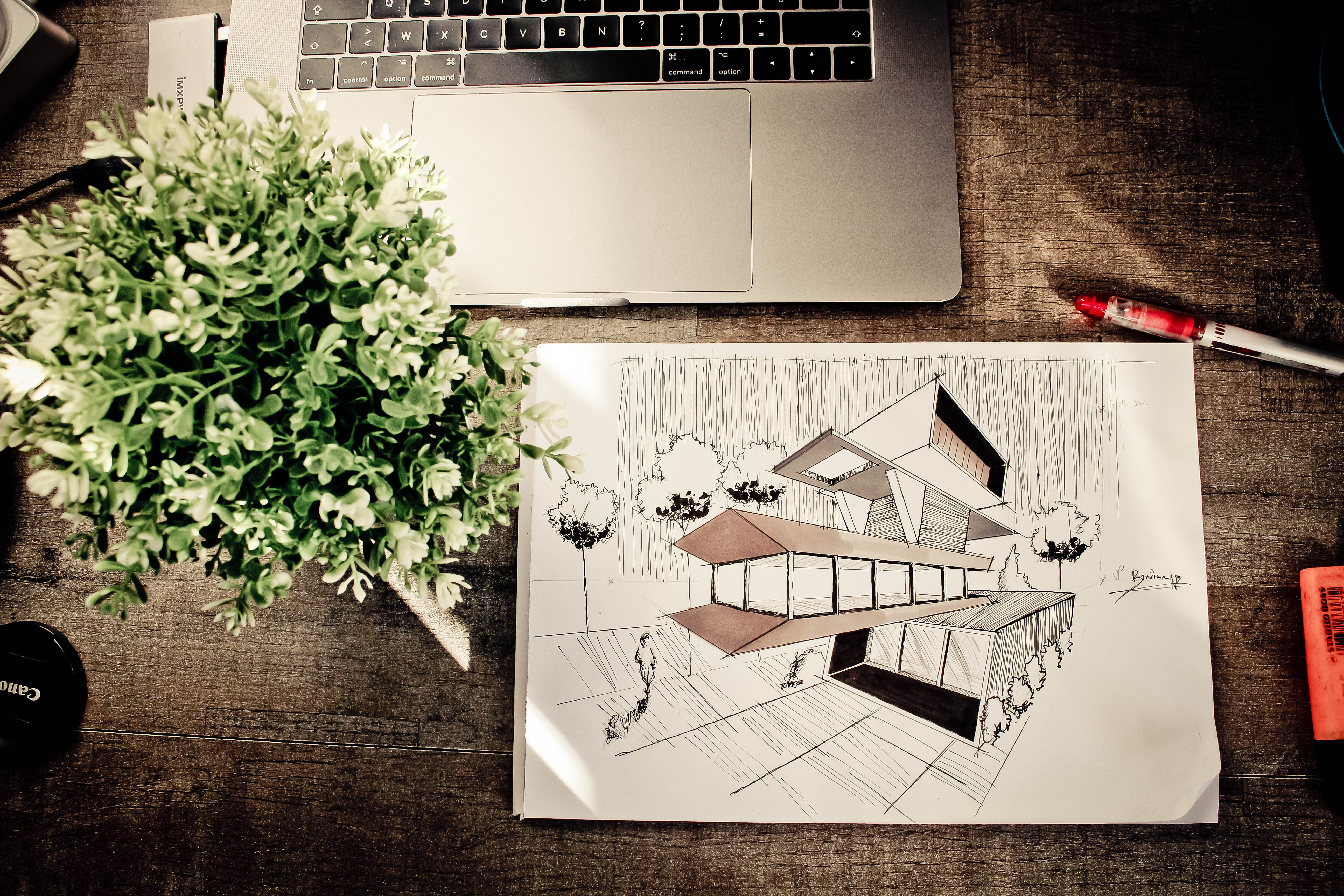 Brown House Illustration on Brown Wooden Table