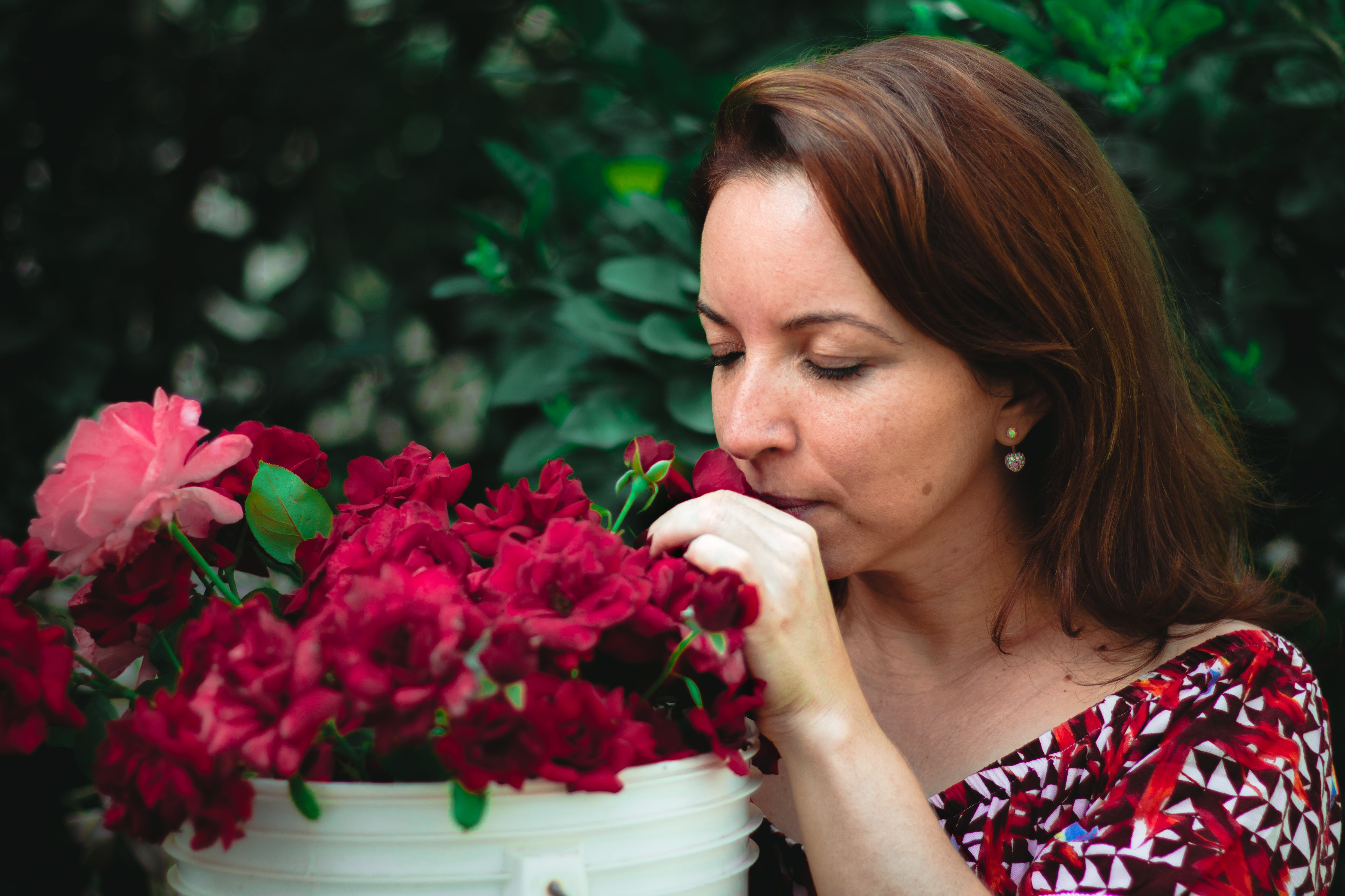 Free stock photo of flowers, smelling, woman