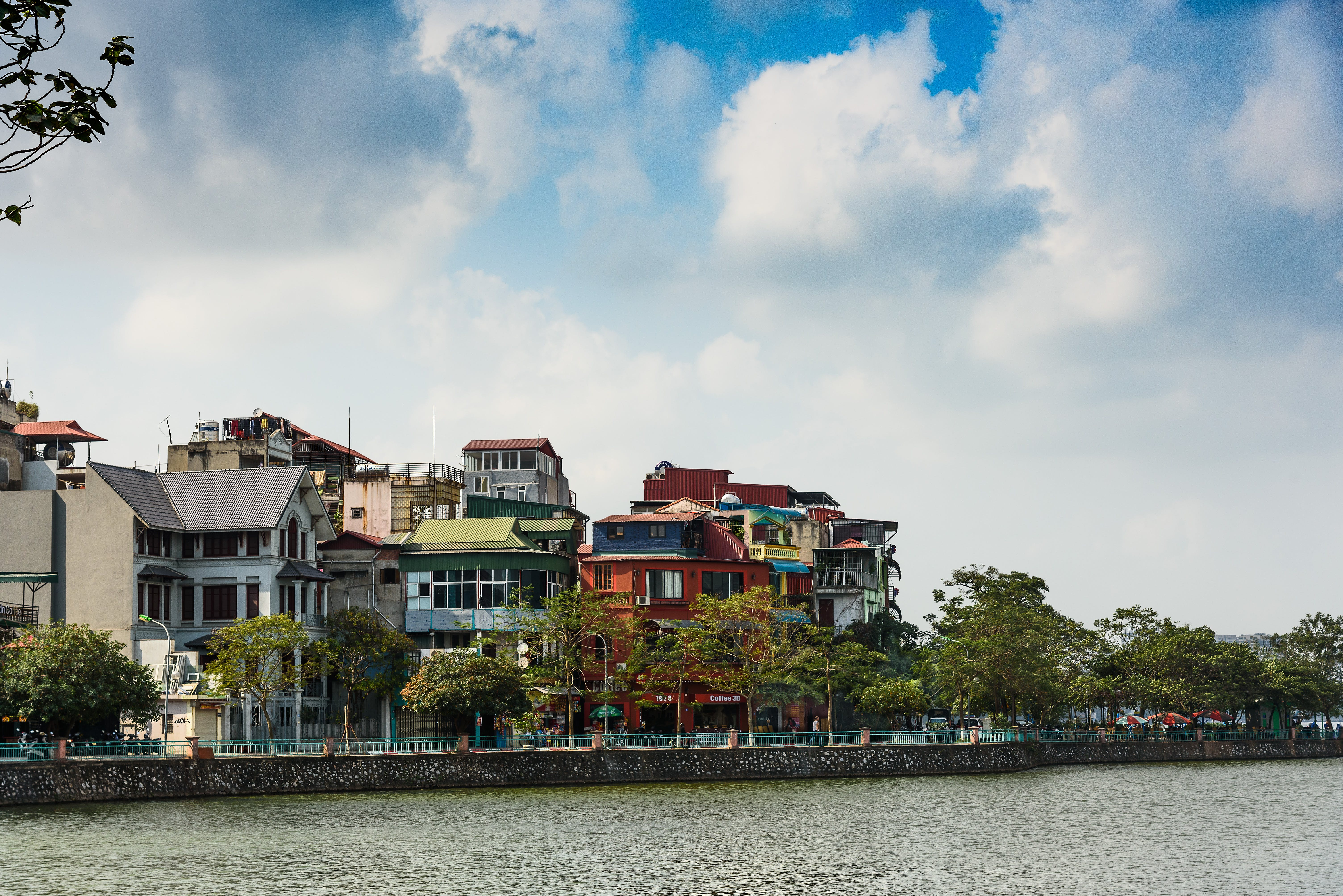 Assorted-color Buildings Near Water and Trees