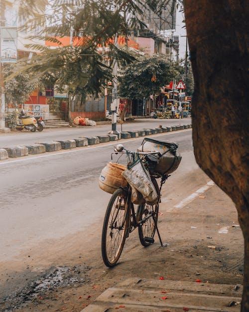 Brown and Black Bicycle on Road