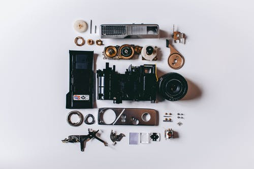 Flat Lay Photography of Black and Gray Components on White Surface