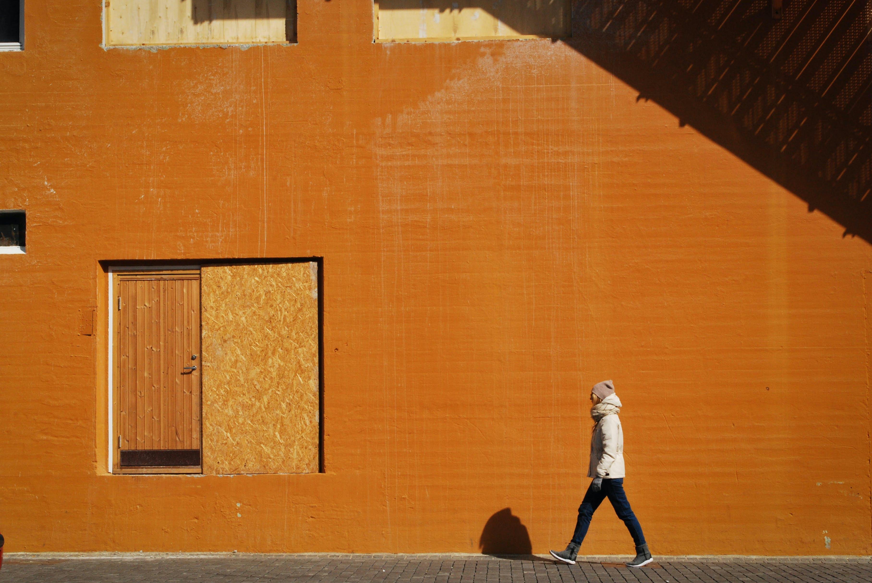 Person Walking on Sidewalk
