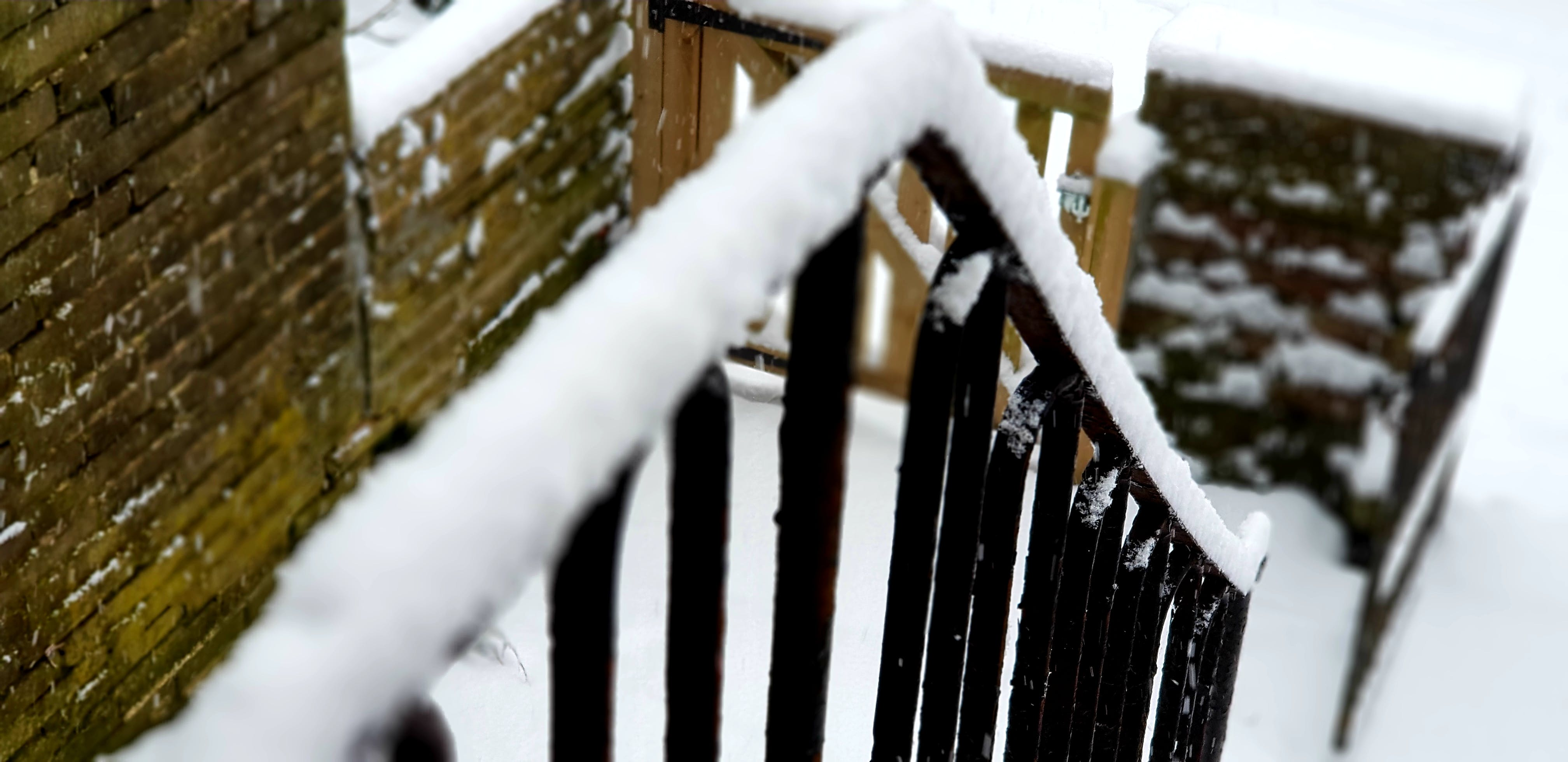 Shallow Focus of Black Stair Frames Covered in Snow