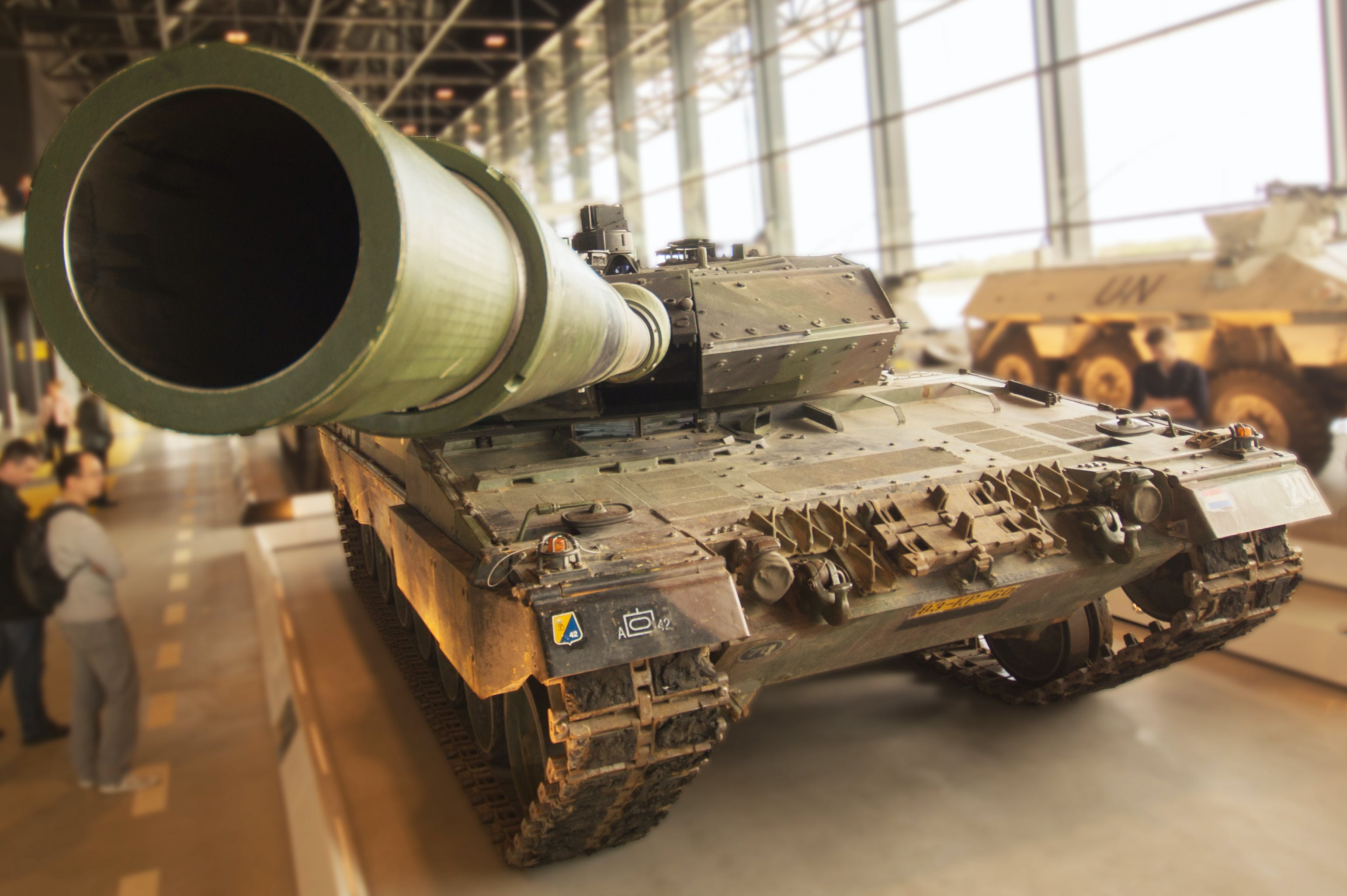 Selective Focus Photography of Brown and Green Battle Tank