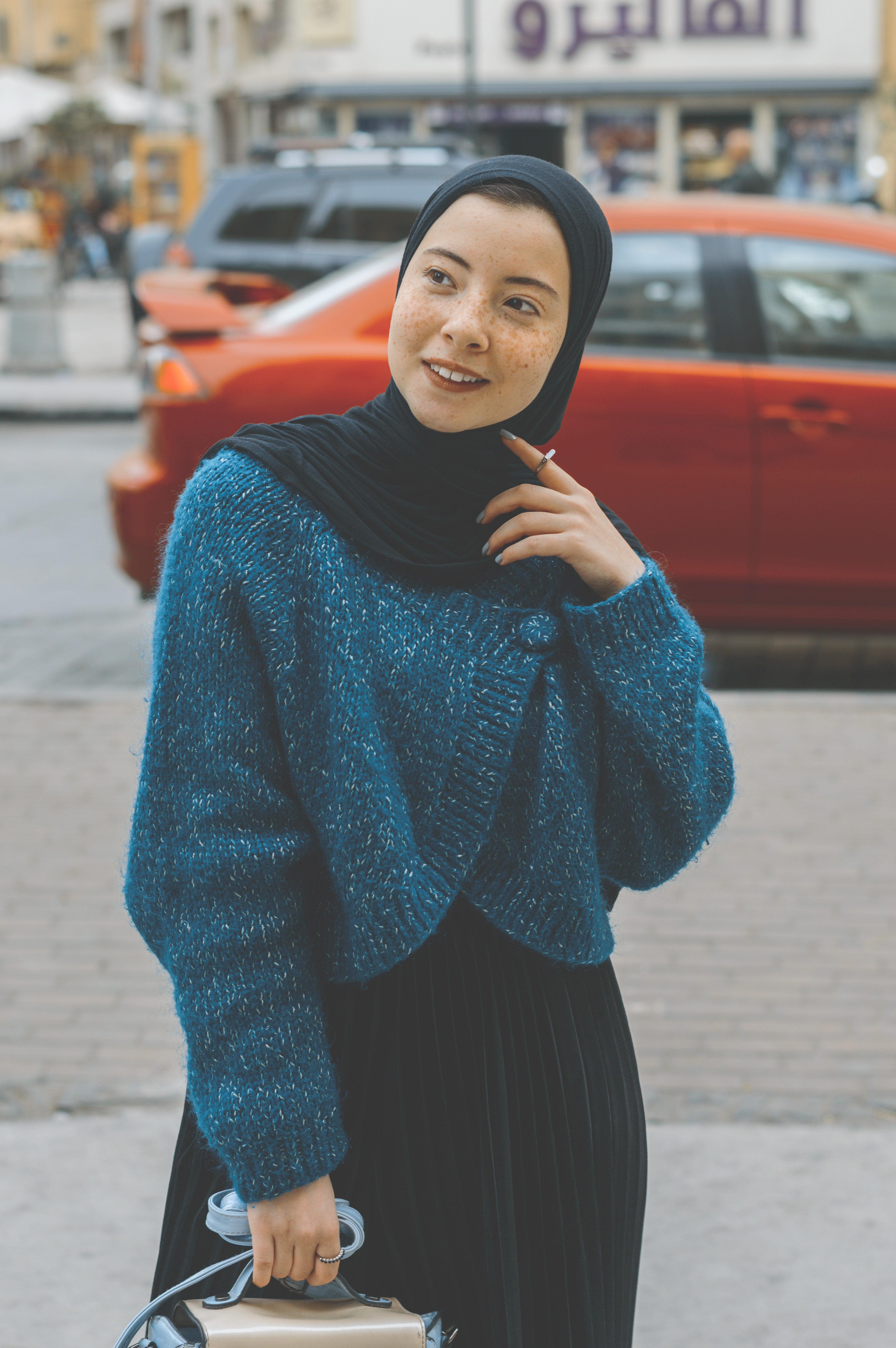 446a2583e1 Woman in Blue Sweater With Black Hijab Outfit · Free Stock Photo